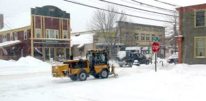 Snow removal equipment was out on Norway's Main Street on Monday morning as the third major storm in a seven-day period was expected to dump up to a foot of snow in Oxford County and beyond.